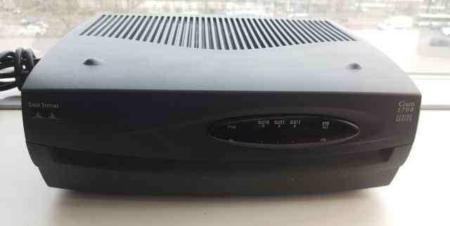 Cisco 1751V + WIC-4ESW + VIC-2FXS